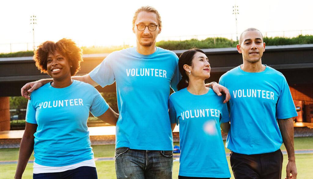 Group of volunteers hugging each other
