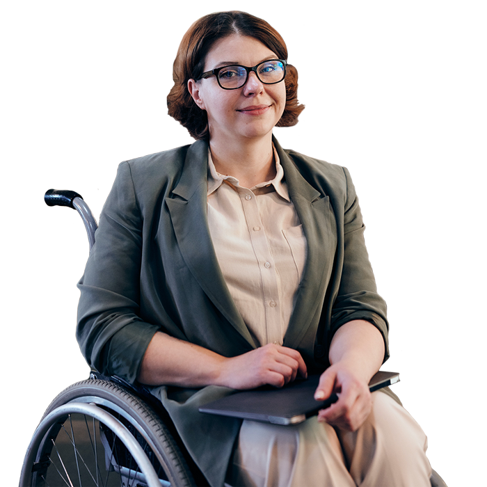 Smiling woman sitting in wheelchair holding a laptop