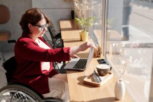 A businesswoman in a wheelchair working on her laptop