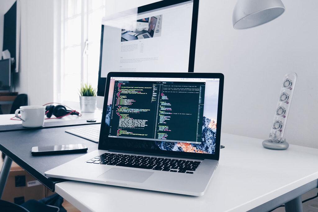 A laptop computer showing website code